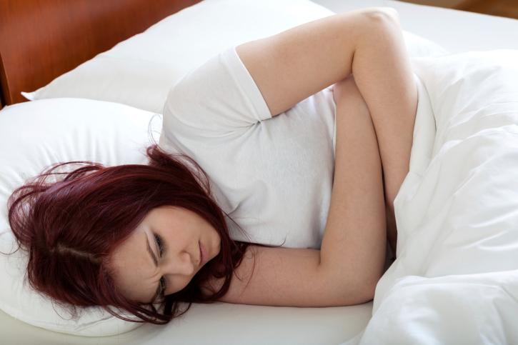 Woman having stomachache
