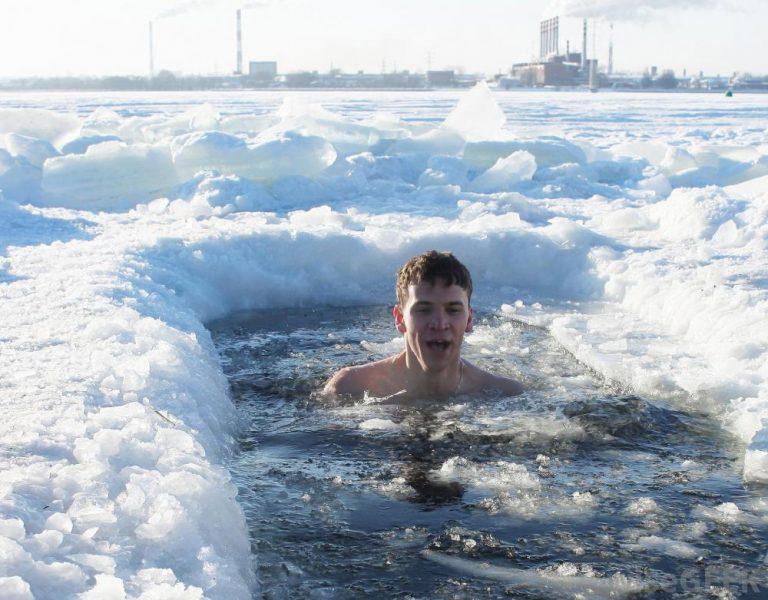 man-in-ice-water-near-snow
